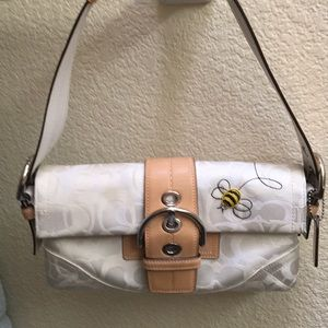 White Coach handbag with embossed bumble bee